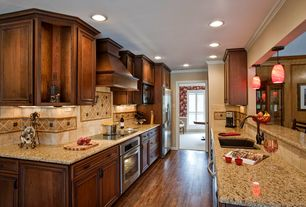Craftsman Kitchen with Pendant light, Cambria - canterbury, Simple granite counters, Flat panel cabinets, Crown molding