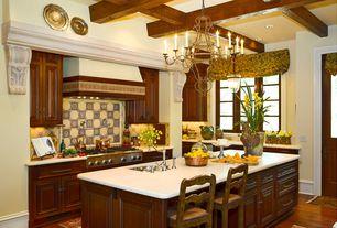 Mediterranean Kitchen with Custom hood, Glass panel door, Exposed beam, Large Ceramic Tile, L-shaped, Undermount sink, Flush