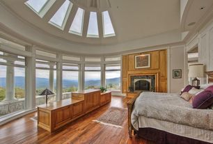 Traditional Master Bedroom with High ceiling, Hardwood floors, picture window, Skylight, Casement, Crown molding, can lights