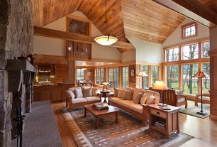 Craftsman Great Room with can lights, stone fireplace, French doors, Pendant light, Casement, Fireplace, picture window, Loft