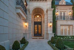 Mediterranean Exterior of Home with Glass panel door, Pathway, Deck Railing, Transom window, exterior stone floors