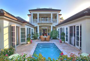 Tropical Swimming Pool with Fountain, French doors, exterior stone floors, Transom window, picture window, Deck Railing