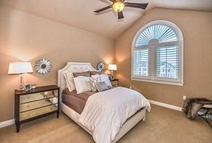Traditional Guest Bedroom with Leila Sunburst Mirror, Carpet, Ceiling fan, Arched window