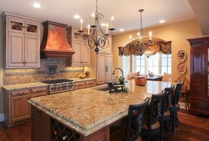 Mediterranean Kitchen with Paint, One-wall, Valance, Complex granite counters, can lights, Hardwood floors, Built-in seating