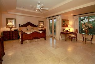 Traditional Master Bedroom with Ceiling fan, French doors, sandstone tile floors