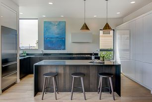 Modern Kitchen with Custom hood, European Cabinets, Slate counters, U-shaped, Slate, Jean Prouve Tabouret Haut, Pendant light