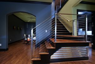 Contemporary Staircase with Crown molding, Hardwood floors, High ceiling