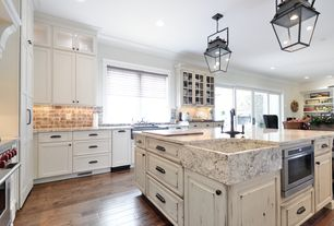 Country Kitchen with Crown molding, Complex marble counters, Viking undercounter drawermicro, Glass panel, Kitchen island