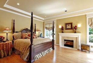 Traditional Guest Bedroom with Crown molding, French doors, flush light, stone fireplace, Laminate floors