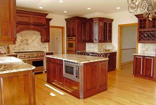 Traditional Kitchen with L-shaped, full backsplash, can lights, double wall oven, Raised panel, Breakfast bar, Glass panel