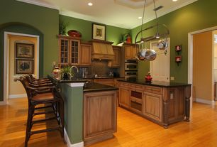 Traditional Kitchen with Crown molding, can lights, electric cooktop, Glass panel, Glass Tile, six panel door, U-shaped