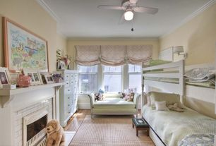 Cottage Kids Bedroom with insert fireplace, bedroom reading light, Hardwood floors, flush light, double-hung window