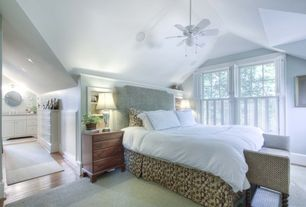 Cottage Guest Bedroom with Carpet, Built-in bookshelf, specialty window, Cathedral ceiling, Ceiling fan, can lights
