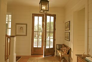 Traditional Entryway with Urban classic pecan engineered hardwood, Painted wood panel wall, French doors