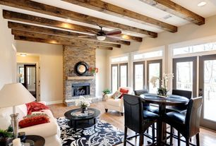 Contemporary Great Room with Standard height, stone fireplace, Fireplace, Ceiling fan, Hardwood floors, Exposed beam