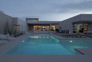 Modern Swimming Pool with exterior tile floors, Outdoor shower, Pathway, Raised beds, French doors, Fence