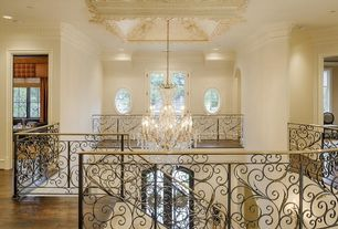 Traditional Staircase with High ceiling, sandstone floors, curved staircase