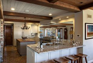Country Kitchen with Custom hood, Pendant light, U-shaped, specialty door, Undermount sink, Butcher block island countertop