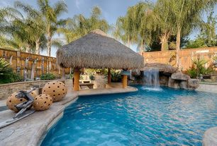 Tropical Swimming Pool with exterior stone floors, Other Pool Type, Fence, Raised beds