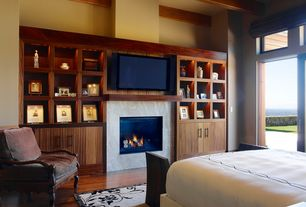 Contemporary Master Bedroom with Fireplace, stone fireplace, Hardwood floors, High ceiling, French doors, Transom window