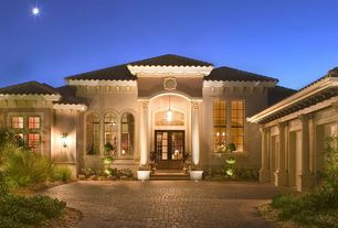Mediterranean Exterior of Home with exterior brick floors, Paint 1, Outdoor light, Topiary
