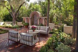 Mediterranean Patio with Bird bath, Fence, exterior brick floors