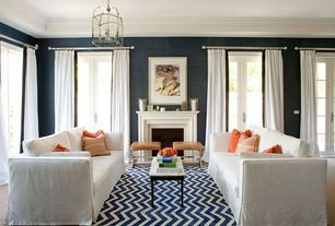 Contemporary Living Room with Phillip Jeffries Juicy Jute Grasscloth, Crown molding, interior wallpaper, Slipcovered sofa