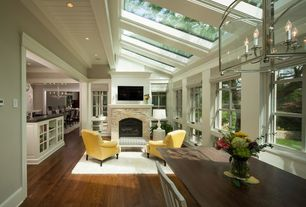 Traditional Living Room with can lights, Casement, Fireplace, Paint, Skylight, stone fireplace, Glass boxed chandelier