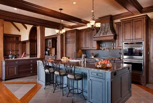 Country Kitchen with Kitchen island, stone tile floors, Soapstone, Exposed beam, slate tile floors, Undermount sink, L-shaped
