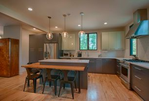 Contemporary Kitchen with Kitchen island, can lights, Wall Hood, Freestanding Full Size Top Freezer Refrigerator, L-shaped