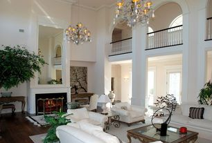 Traditional Great Room with Chandelier, High ceiling, French doors, Crown molding, specialty door, Columns, Loft, Wall sconce