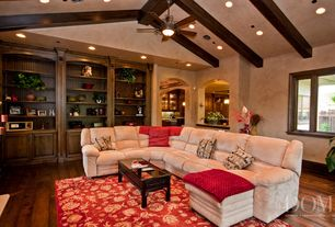 Mediterranean Living Room with Casement, can lights, Hardwood floors, Exposed beam, Built-in bookshelf, Fireplace