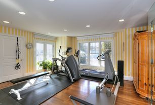 Traditional Home Gym with double-hung window, Standard height, French doors, specialty door, can lights, Hardwood floors