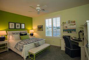 Cottage Master Bedroom with Standard height, Ceiling fan, Carpet, Casement, Built-in bookshelf