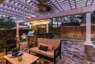 Cottage Porch with Trellis, exterior stone floors, Fence, Outdoor kitchen