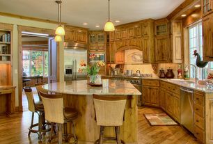 Country Kitchen with built-in microwave, can lights, Breakfast bar, Kitchen island, full backsplash, Undermount sink, Flush