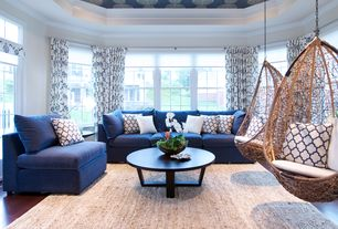 Contemporary Living Room with Bird's nest hanging chair, Tray ceiling, Crown molding, Area rug, Sectional sofa, Wallcovering