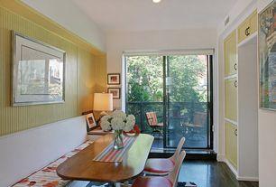 Traditional Dining Room with picture window, sliding glass door, Built-in bookshelf, Hardwood floors, Standard height