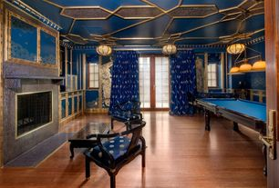 Art Deco Game Room with Built-in bookshelf, flush light, Wainscotting, picture window, Hardwood floors, French door, Casement