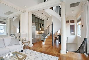 Contemporary Great Room with High ceiling, Columns, Hardwood floors, Built-in bookshelf