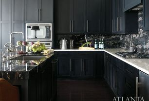 Traditional Kitchen with dishwasher, Complex granite counters, Flat panel cabinets, Hardwood floors, shaker door, wall oven