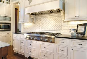 Cottage Kitchen with L-shaped, Soapstone counters, Herringbone Tile, Subway Tile, High ceiling, Flat panel cabinets