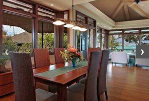 Tropical Dining Room with Paint, sliding glass door, picture window, Transom window, Exposed beam, Pendant light, can lights