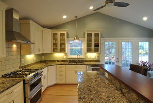 Modern Kitchen with Complex granite counters, Inset cabinets, Pental - coliseu polished granite, Flat panel cabinets