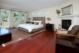 Traditional Master Bedroom with Hardwood floors, Built-in bookshelf, Cement fireplace