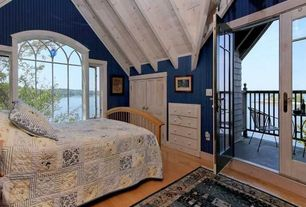 Cottage Guest Bedroom with interior wallpaper, Built-in bookshelf, Laminate floors, Hyder Torino Guest Bed with Trundle
