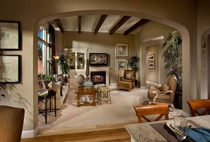 Contemporary Living Room with Exposed beam, Stonemark Granite Countertop in New Venetian Gold, Cement fireplace, Casement