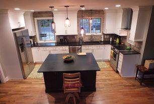 Traditional Kitchen with Glass Jar Pendant, Tall, Gray, Travertine, Flush, Flat panel cabinets, Undermount sink, U-shaped