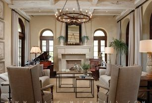 Traditional Living Room with Transom window, Arched window, Hardwood floors, Box ceiling, French doors, Chandelier