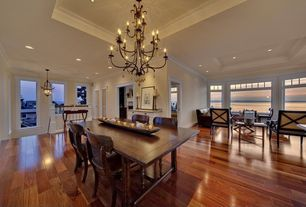 Contemporary Great Room with Hardwood floors, High ceiling, Pendant light, can lights, Transom window, Glass panel door